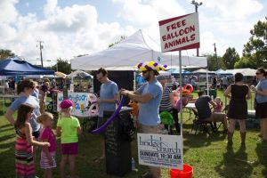 Bridge Church in Madisonville, doing free balloon animals & face painting at a local festival in 2014.