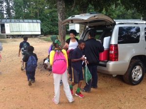 Members of Stillwater Church in Hammond pass out healthy snacks to kids getting off the bus at a local mobile home park.