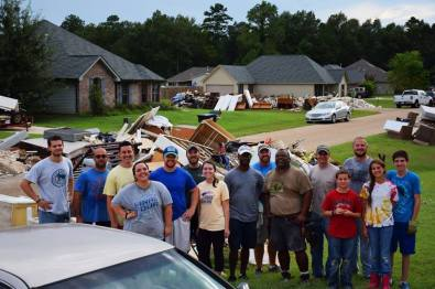 Small group helping a family mud out after this years Louisiana floods.